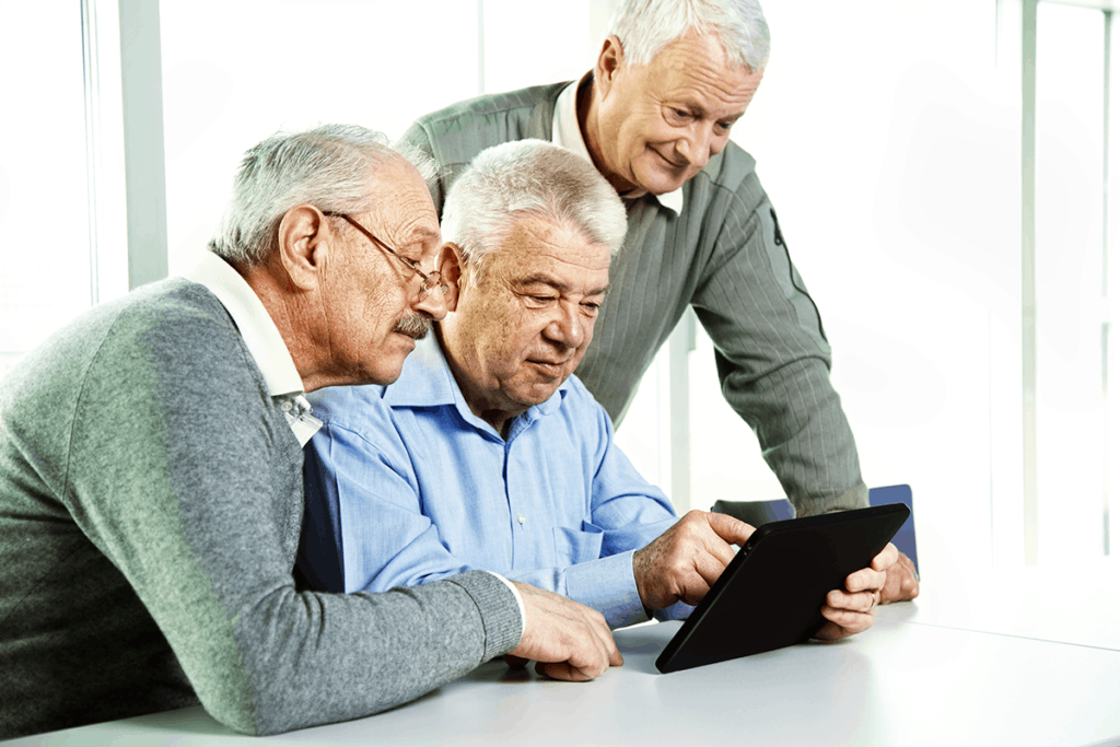 Three SeniorNet men on tablet